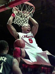 UC's Jermaine Tate slams one home in the second half against UNC Carlotte at the Shoemaker Center in 1999.