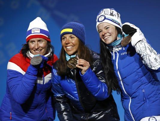 Marit Bjoergen,Charlotte Kalla,Krista Parmakoski