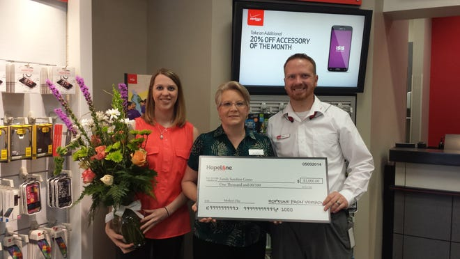 Verizon Wireless presented a $1,000 donation to the Family Sunshine Center in Montgomery as part of its HopeLine program.