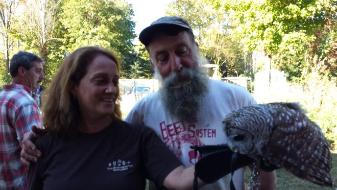 Wildlife rehabilitator Annie Mardiney with her friend Ray Bradley last fall, and The Professor, one of her education owls.