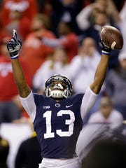 Penn State's Saeed Blacknall (13) celebrates making a 40-yard touchdown reception during the first half of the Big Ten championship NCAA college football game against Wisconsin, Saturday, Dec. 3, 2016, in Indianapolis. (AP Photo/AJ Mast)