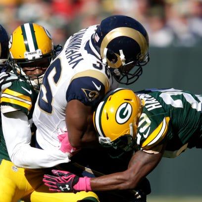 Green Bay Packers' Damarious Randall (23) and Green