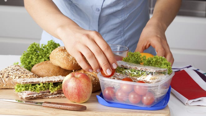Experts say planning and packing lunch can keep your health goals on track.
