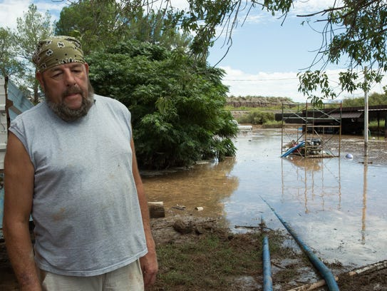 Mark Sale, a resident of Doña Ana, stands in his property