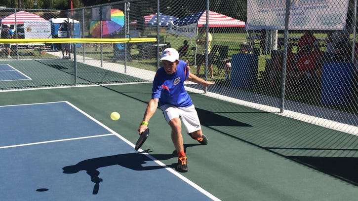 Fort Myers' Kyle Yates, 20, won silver and bronze medals in a national pickleball tournament in Utah.