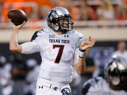 FILE - In this Sept. 25, 2014,  file photo, former Texas Tech quarterback Davis Webb prepares to throw during an NCAA college football game against Oklahoma State in Stillwater, Okla. Webb, a graduate transfer, has been named the starting quarterback for California. (AP Photo/Sue Ogrocki, File)