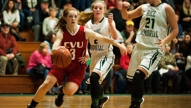 CVU's Sadie Otley (3) drives to the hoop past Rice's Jordan Lawrence (2) and Rachel Chicoine (21) during the girls basketball game between the Champlain Valley Union Redhawks and the Rice Green Knights at Rice high school on Friday night December 19, 2014 in South Burlington, Vermont. (BRIAN JENKINS, for the Free Press)