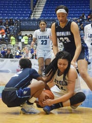 Loyola Prep's Chelsea Johnson (34, right) and Ursuline Academy's Tai Sherman (12, left) grapple for the ball in the LHSAA Division II semifinals held Tuesday, Feb. 27, 2018 at the Rapides Parish Coliseum in Alexandria.
