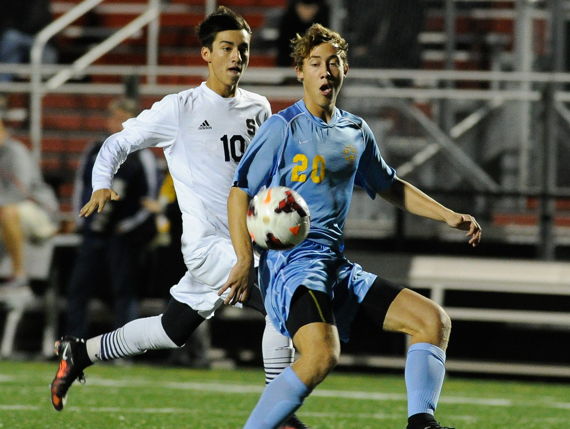 Cape Henlopen's #20 Luke Mulcahy and Salesianum's #10 Gavin Ford run for the ball in the first half of the DIAA Division I soccer semifinal game at Smyrna High School.