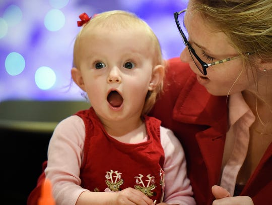 Tori Heidebrink, 1, lets out a scream when she sees