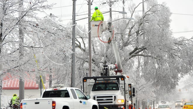 Utility workers began to assess damange of the ice storm on Sunday, Dec. 22, 2013.