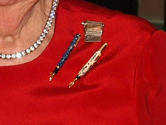 Albright's pins show her support for the press.