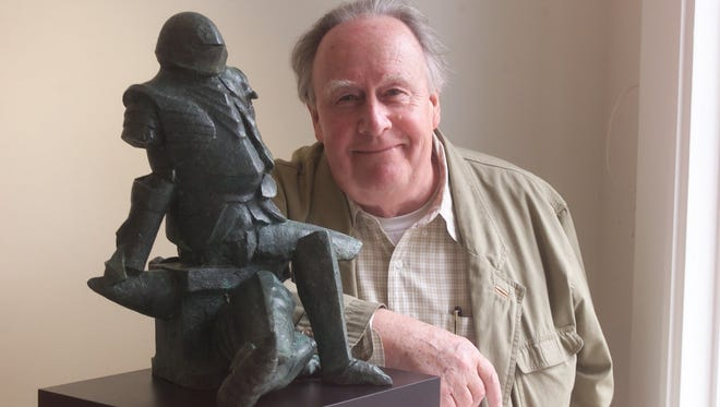 """Sculptor Jay Holland in 2001 with his work titled """"Broken Knight."""""""