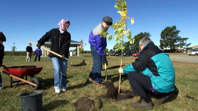 On Oct. 2, 1999, 10 years after the abduction of Jacob Wetterling in St. Joseph, Andrea Terhaar, left, Jerry Wetterling and Steve Dehler, all from St. Joseph, planted 10 trees at Klinefelter Park in St. Joseph.