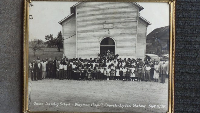 A typical Sunday in 1951 at Wayman Chapel, Lyles Station, Ind., is shown in this photo provided by Stanley Madison.  The Gibson County town founded by former slaves before the Civil War. The town once had a general store, railroad station, post office and 50 homes populated by blacks who are descended from the two freed-slave brothers who gave the town its name in 1886. (AP Photo)