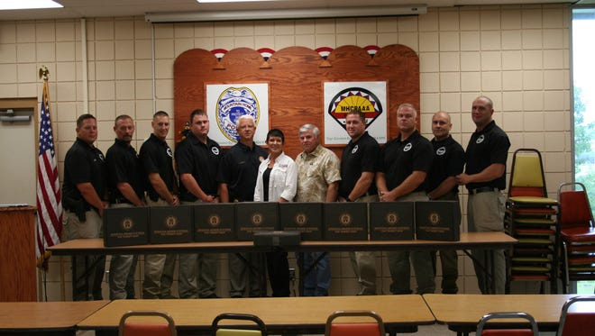 Pictured and presenting the body armor to the Mountain Home Police Department are Twin Lakes Gun Club President Floyd Lee and Vice President Elka King. Special Response Team members and Police Chief Carry Manuel accept the donation.