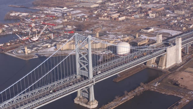 The stone anchorage (right)  of the Ben Franklin Bridge is one of two that help hold up the suspension bridge. The other is on the Philadelphia side.