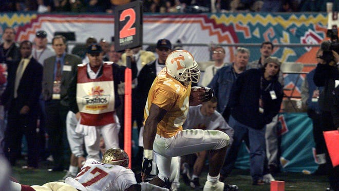 Tennessee's Shawn Bryson evades a tackle for UT's first score in the Fiesta Bowl against Florida State on Jan. 4, 1999.