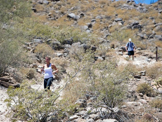Hikers make their way down the Cholla Trail at Camelback