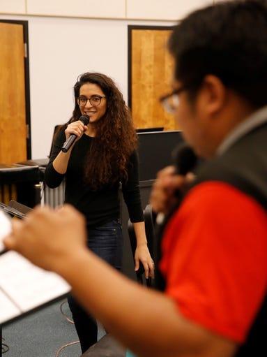 Megan Lopez Quintana and Delbert Anderson share vocal