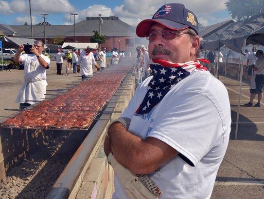 Rotarian Brad Westfall waits for more racks of chicken