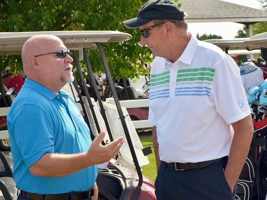 Farmington Hills Mayor Ken Massey speaks with John