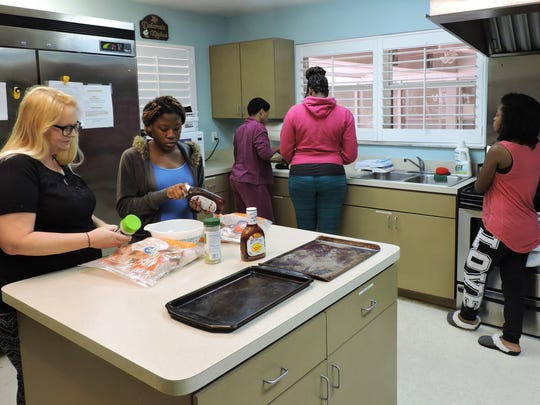Mary's Shelter residents Jessica, left, Samantha, Jasi, Rai and Valencia share cooking chores. The residents take turns preparing dinner every night.