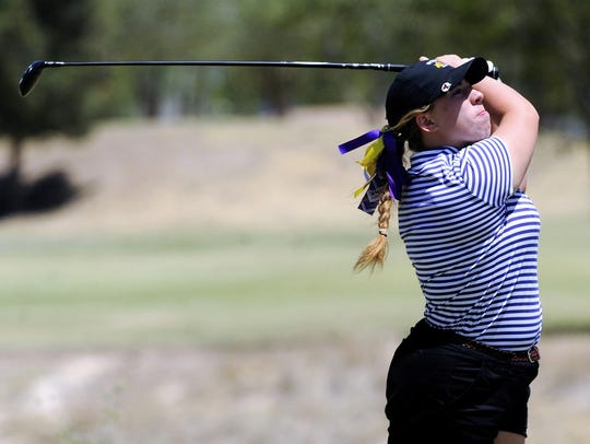 Wylie's Andrea Davis tees off from the No. 14 hole during the Region I-4A tournament second round at Shadow Hills Golf Course in Lubbock on Thursday.