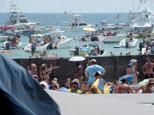 Fans await the start of Kenny Chesney's Flora-Bama-Jama concert Saturday at the Flora-Bama Lounge and Package on Perdido Key.