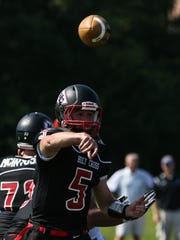 Holy Cross quarterback Dylan Couch fires a pass during