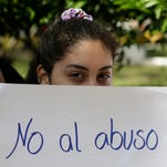 People protest against child abuse, demanding stronger penalties for violators, in downtown Asuncion Paraguay, Monday, May 11, 2015. The nation has been split over the case of a pregnant 10-year-old girl denied an abortion. Police said Saturday they had arrested the girl's fugitive stepfather, who is accused of raping the child.