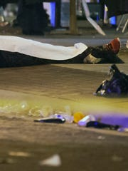 The body of Expavious Tyrell Taylor, 20, lies in downtown Fort Myers after Taylor was shot and killed at Zombicon on Oct. 17, 2015. Five other people were also injured in the shooting.