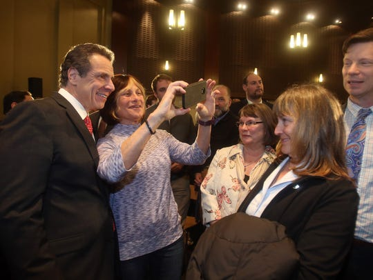 New York Governor Andrew Cuomo takes a photo with Joanne