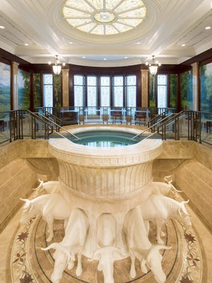 Members of The Church of Jesus Christ of Latter-day Saints perform proxy baptisms for the deceased in baptisteries like this one in the new Payson, Utah Temple.