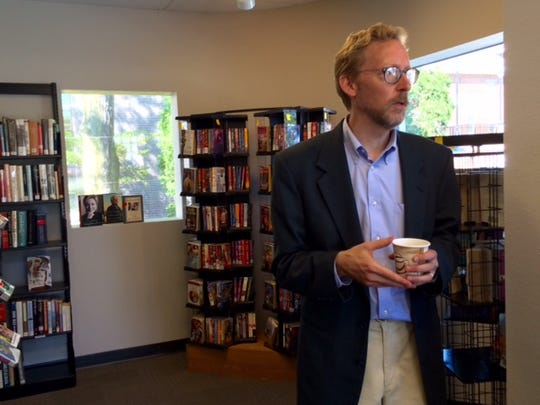 Fond du Lac Public Library Director Jon Mark Bolthouse talks to visitors on Sept. 12 at the library's new used bookstore, Chapter 52, located at 52 Sheboygan St.