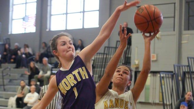 Nanuet's Zoe Amalbert tries to get off a shot under pressure from Clarkstown North's Nieve Donegan during their game at Nanuet High School, Jan. 7, 2017.