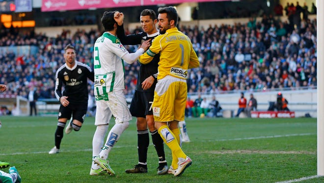 Cristiano Ronaldo, center,  reacts after he kicked an opposing player against Cordoba.