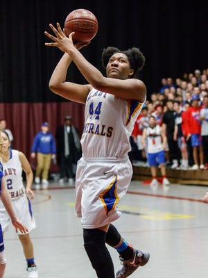 Rufus King junior Sydnee Roby (44) takes flight for a shot during the WIAA Division 1 sectional final against  Oak Creek at West Allis Central on Saturday, March 3, 2018.
