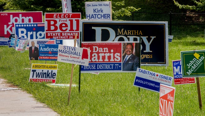 Campaign signs line Decatur Street in Montgomery, Ala., in preparation for the primary election on Tuesday.