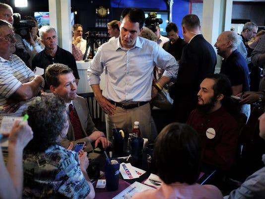 Republican hopeful Scott Walker campaigns