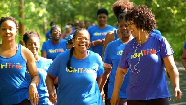Angelia Hall, front left, of Aurora, Ill.,  Chrysantha Norwood, center, of Detroit and Cassandra Webster, right, of Memphis lead a group of GirlTrek  volunteers from across the country during a training trek.