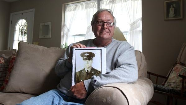 Richard Donovan of Neptune City, N.J., holds a scrapbook dedicated to his brother David, a former U.S.  pilot during World War II.