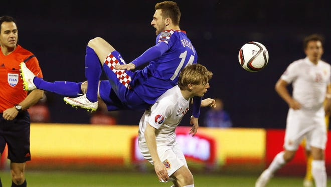 Norway's Mats Moller Daehli in action against Croatia's Marcelo Brozovic during the UEFA EURO 2016 qualifying soccer match between Croatia and Norway.