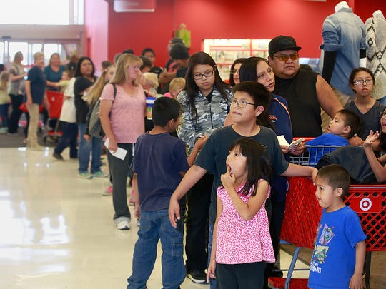 The Yellowhair family waits in line before shopping for new clothes on Thursday during the Clothes for Kids event at Target.