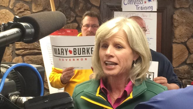 Democratic gubernatorial candidate Mary Burke speaks with reporters at the headquarters of the Democratic Party of Brown County on Saturday.