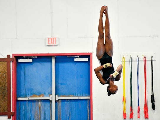 Trinity Thomas conducts her floor exercise Friday,