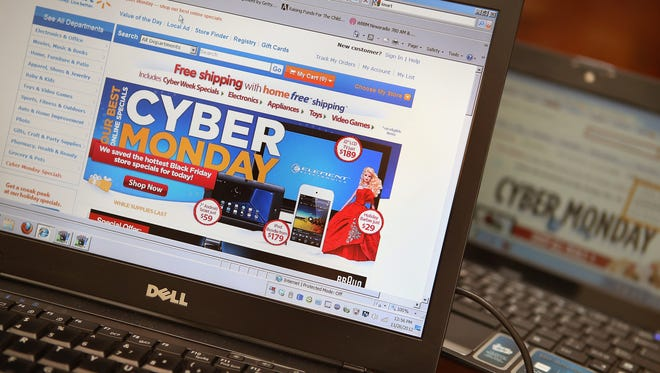 CHICAGO, IL - NOVEMBER 26:  Retailers advertise Cyber Monday deals on their websites on November 26, 2012 in Chicago, Illinois. Americans are expected to spend $1.5 billion while shopping online today, up 20 percent from last year.  (Photo by Scott Olson/Getty Images)