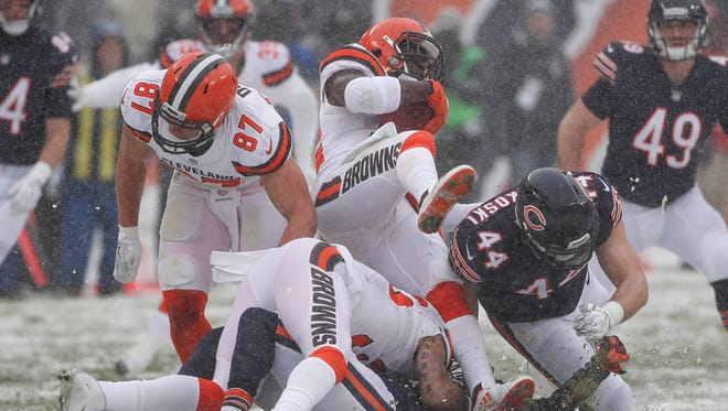 Dec 24, 2017; Chicago, IL, USA; Cleveland Browns free safety Jabrill Peppers (middle) is defended by Chicago Bears inside linebacker Nick Kwiatkoski (44) during the first half at Soldier Field. Mandatory Credit: Kamil Krzaczynski-USA TODAY Sports
