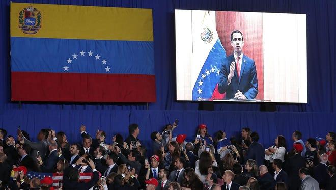 Venezuelan opposition leader Juan Guaido speaks via a telecast to a crowd at Florida International University. South Florida is home to more than 100,000 Venezuelans and Venezuelan-Americans.