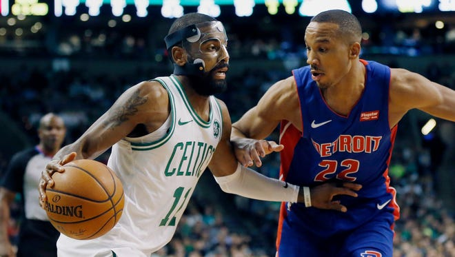 Celtics guard Kyrie Irving (11) drives past Pistons guard Avery Bradley (22) during the first quarter on Monday, Nov. 27, 2017, in Boston.